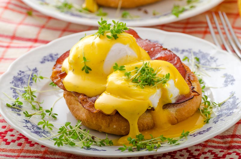 Eggs Benedict with avocado and prosciutto